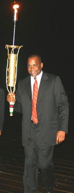 PM Skerrit Carrying Reunion Torch